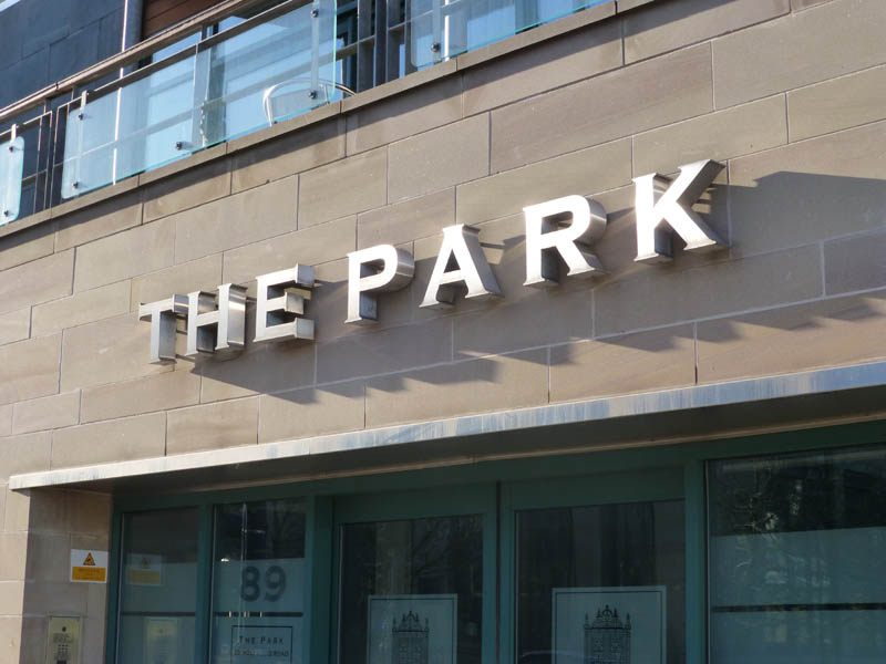 The Park sign over the buidling entrance.