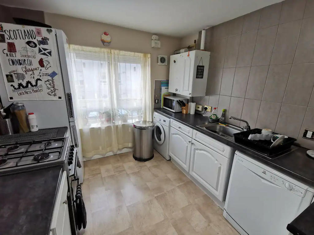 Kitchen with all the standard appliances. Large Fridge Freezer , Microwave, cooker with oven, washing machine and dishwasher