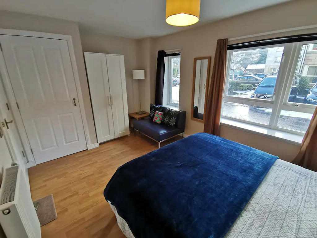 Double bedroom 2 with double bed, bedside cabinets, sofa and wardrobes