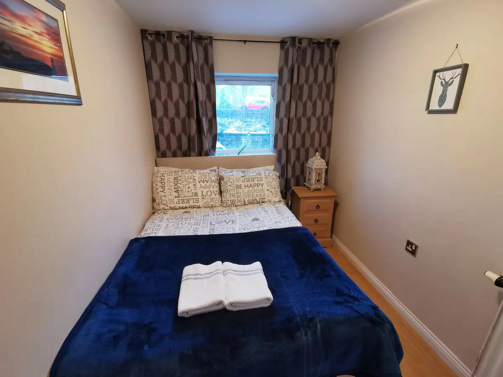 Bedroom 3 with double bed, bedside table and a built-in wardrobe
