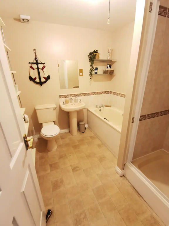 Spacious bathroom with fitted walk in shower and bath