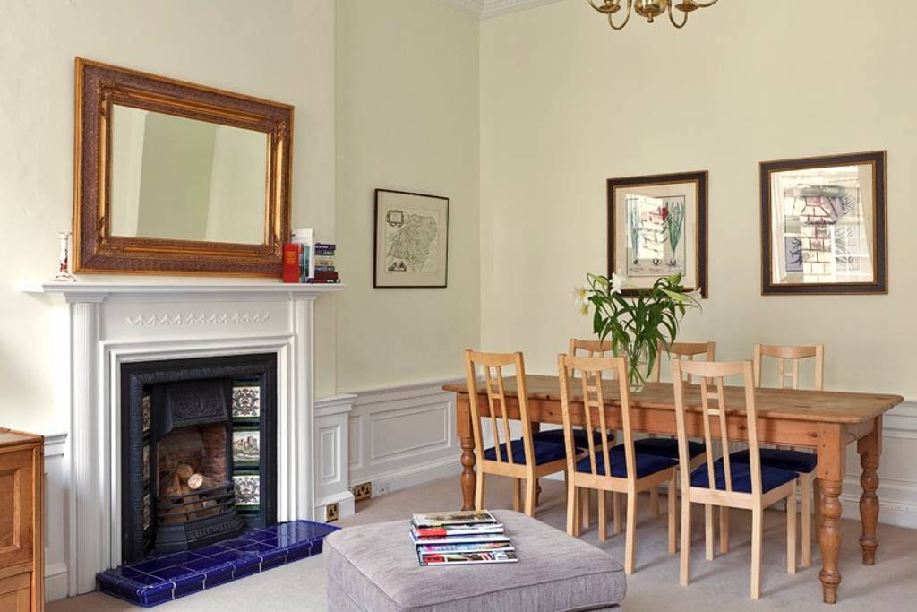 Living room with dining table to seat up to 8 guests