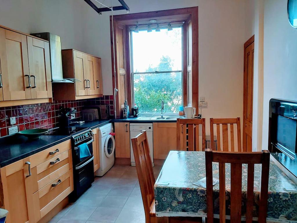 Kitchen with dining table, cooker, washing machine, fireplace, microwave, American size Fridge Freezer & dishwasher