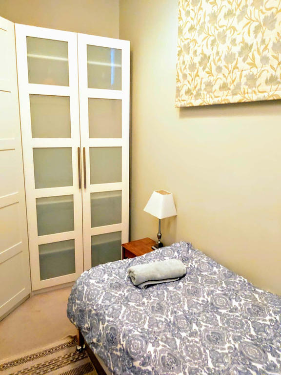 3rd Bedroom - single bed and large wardrobe. This is an Edinburgh Box Room and it has a window facing into the hallway/stairwell