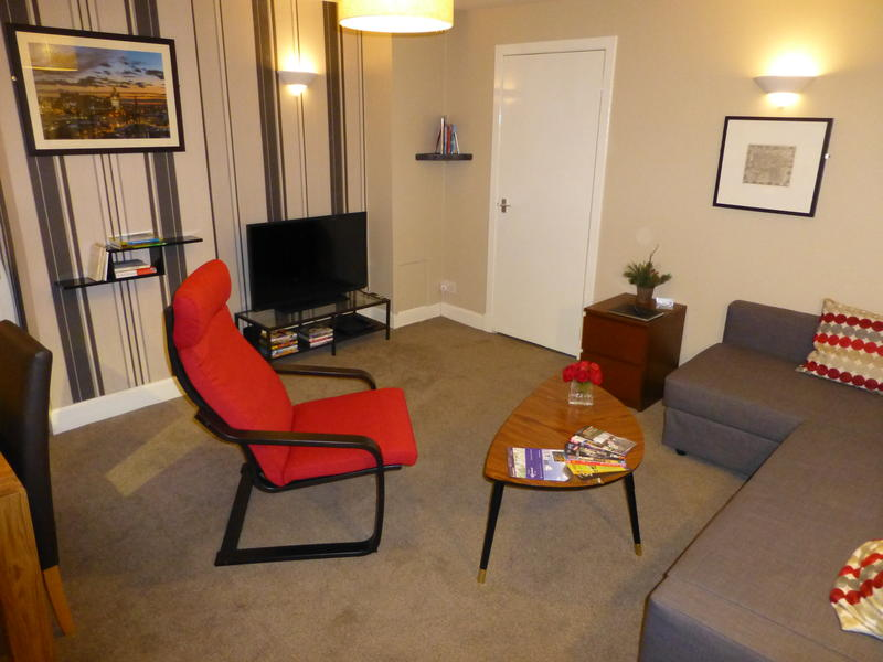 The living room with TV, DVD player and double sofabed