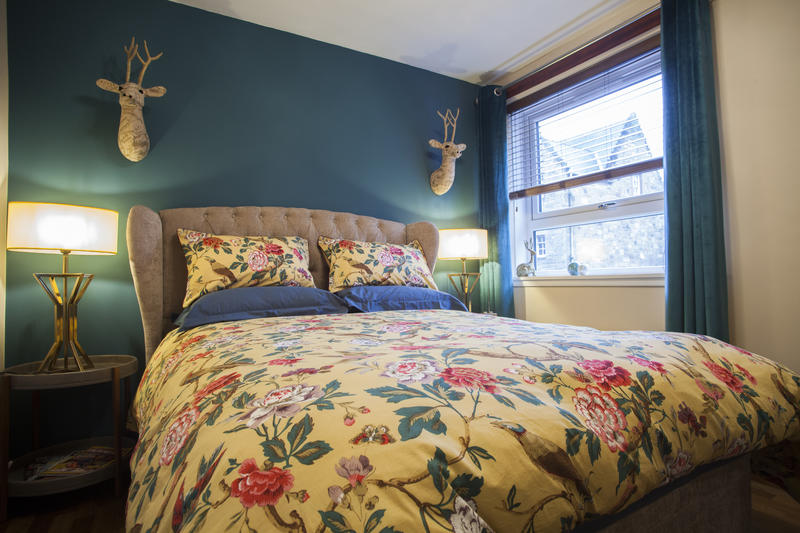 The bedroom has a standard-size double bed