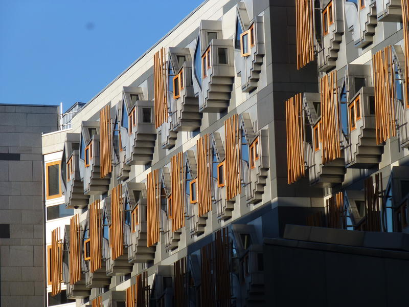 A view of the Scottish Parliament building nearby, which is just across the road from the apartment building