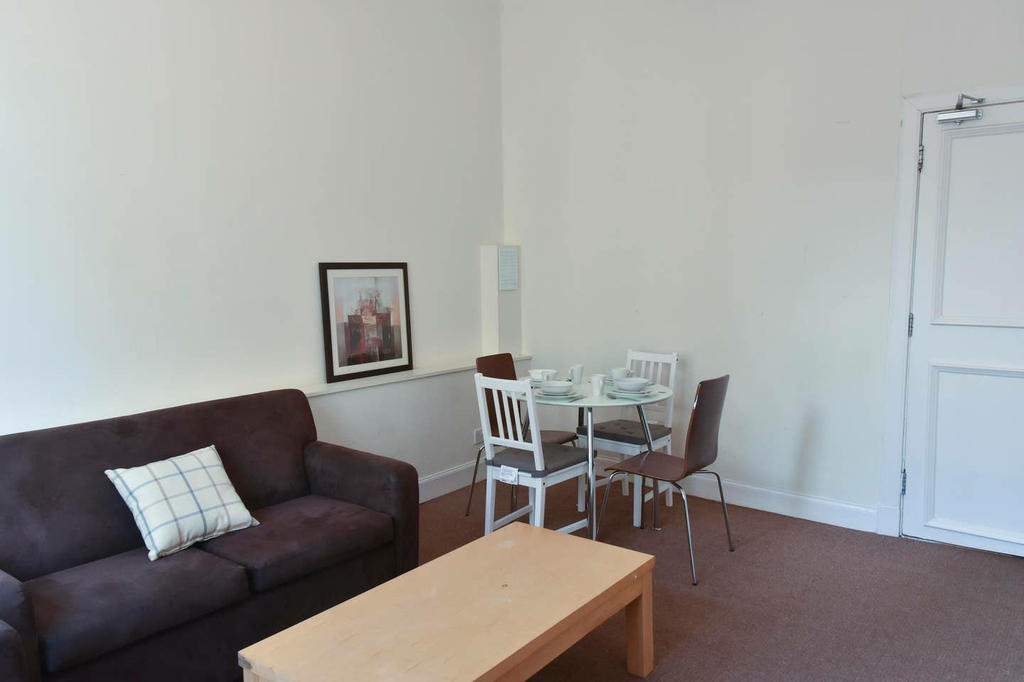 8 / 27 The living room has two 2-seater sofa's and a dining area that seats 4 people.
